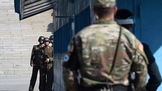 North and South Korean soldiers looking at ech other in DMZ