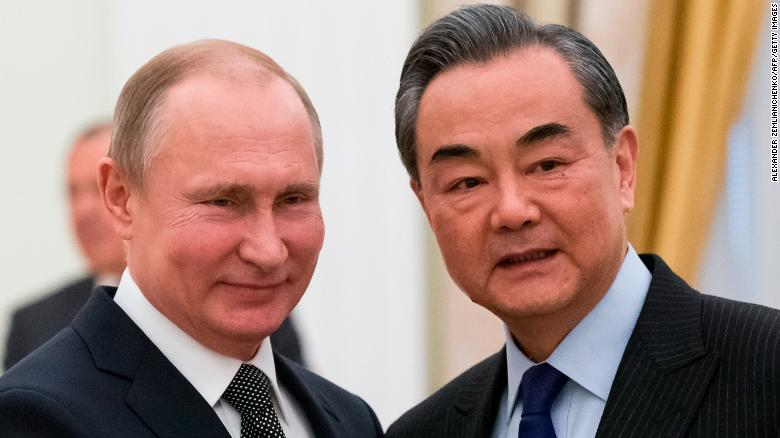 Putin and Wang Yi smiling together