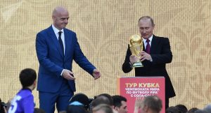 Russian president Vladimir Outin kick starts the FIFA World Cup