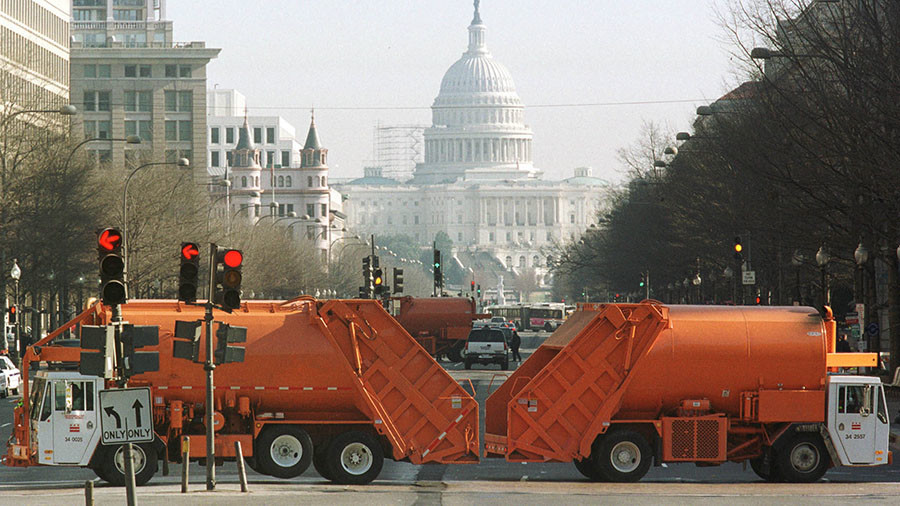Garbage truck in front of white house