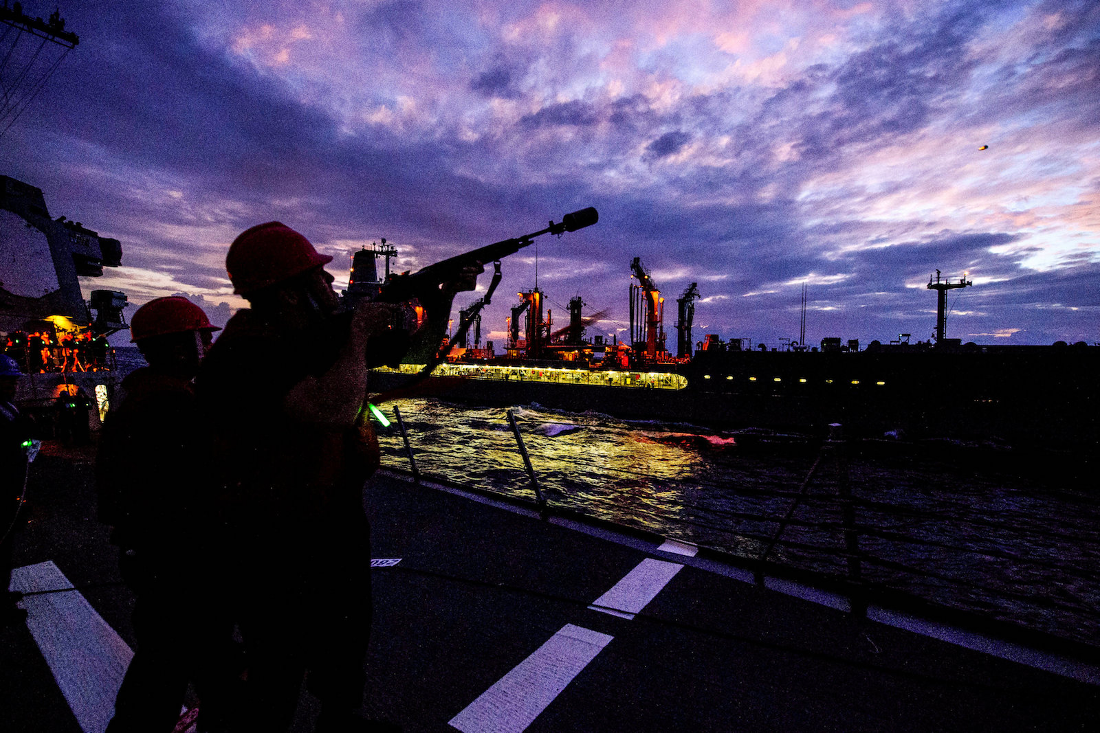 A US Navy gunner on the Arleigh Burke-class guided-missile destroyer USS Mustin in the South China Sea,