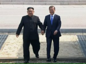 Korean leaders Kim Jong Un and the other guy
