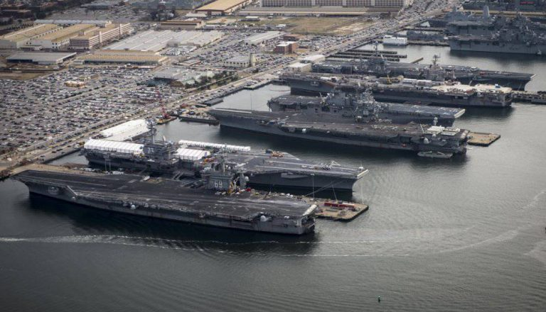 The pride of the US Navy helplessly stuck in port