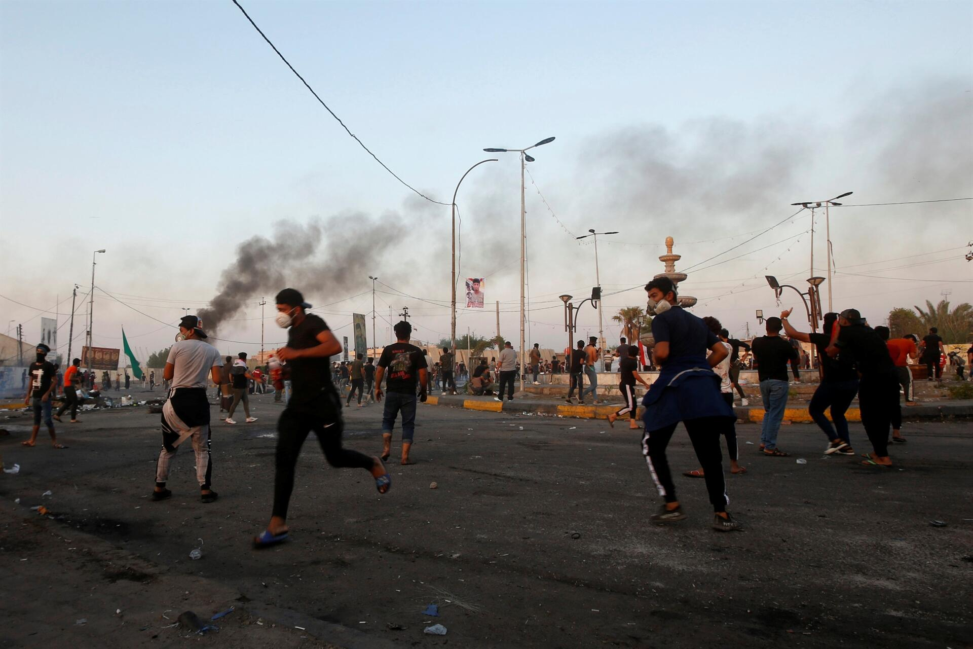 Iraqi PM concedes 'mistakes made' as protesters pushed back in Baghdad