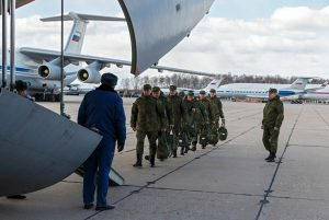 Russian military experts return home from Italy