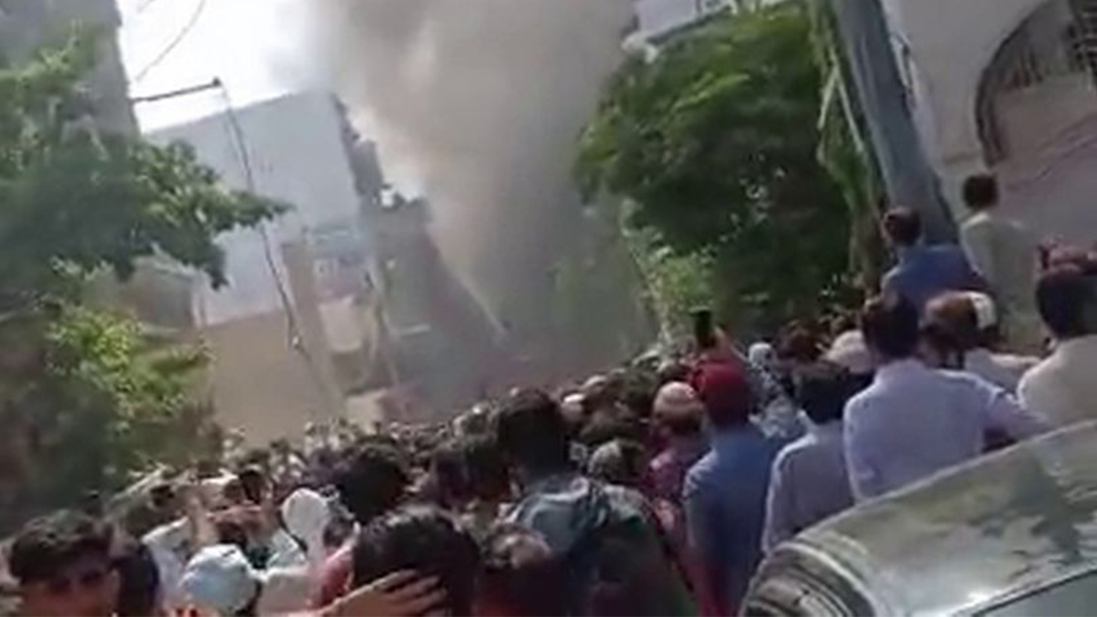 The first shots from the crash site of a passenger airliner on a residential quarter in Pakistan