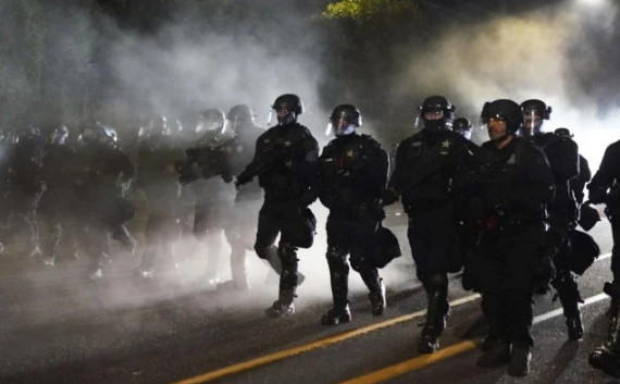 Portland protesters burned down police office
