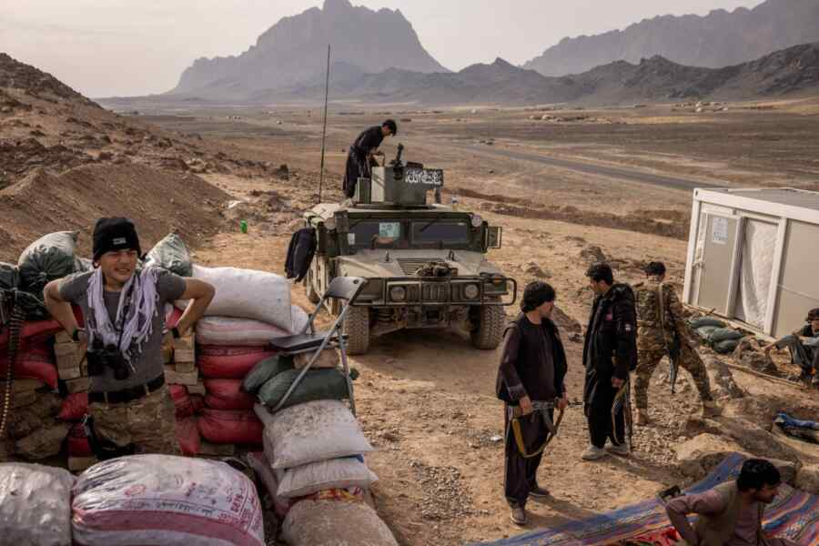 More than a thousand Afghan troops have retreated into Tajikistan after fighting with the Taliban