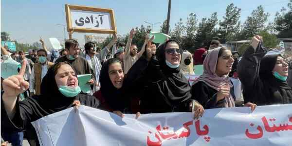Female students hold rally in Kabul in support of the Taliban